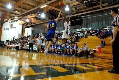 Glenbard West sophomore guard Keith Hayes puts up a three-pointer during a game against Lyons Township on Thursday, Jan. 24, 2013. Matthew Piechalak— mpiechalak@shawmedia.com.