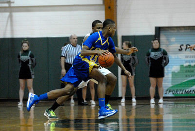 Lyons Township junior forward Chris Hester dribbles outside the perimeter during a game at Glenbard West on Thursday, Jan. 24, 2013. Matthew Piechalak— mpiechalak@shawmedia.com.