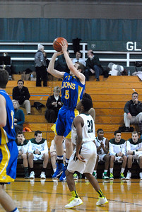 Lyons Township sophomore guard Harrison Niego puts up a jump shot during a game at Glenbard West on Thursday, Jan. 24, 2013. Matthew Piechalak— mpiechalak@shawmedia.com.