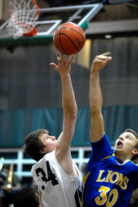 Glenbard West senior center Sean Jenner, left, and Lyons Township junior forward Matt Mrazek battle for the opening tip during a game in Glen Ellyn on Thursday, Jan. 24, 2013. Matthew Piechalak— mpiechalak@shawmedia.com.