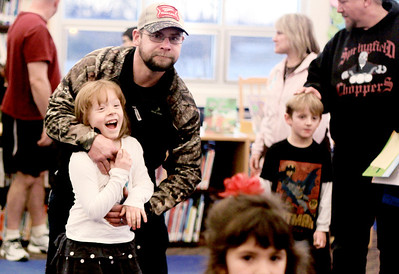 "Sarah Nader - snader@shawmedia.com Jeremy Eslick of Woodstock and his step- daughter Mada Jo Thomas, 6, of Woodstcok joke around while doing yoga during Guy's Night Out at Verda Dierzen Learning Center in Woodstock on Thursday, January 17, 2013. Pre-K and kindergartens brought their ""favorite big guys"" for throwing and catching games, jumping, hopping and balancing activities along with yoga ."