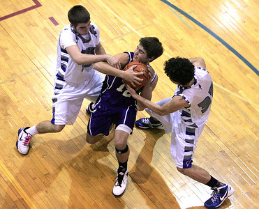Monica Maschak - mmaschak@shawmedia.com Matthew Bridges, from Hampshire, fights for control of the ball in a game at Woodstock High School on Tuesday, January 22, 2013.  Hampshire won 64-49.