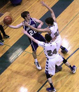 Monica Maschak - mmaschak@shawmedia.com Brendan Waterworth (22) looks for a Hampshire teammate while being double-guarded in the third quarter of a game at Woodstock High School on Tuesday, January 22, 2013.  Hampshire won 64-49.