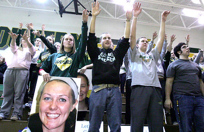 Monica Maschak - mmaschak@shawmedia.com The Crystal Lake South student section raises their arms and gives spirit fingers to cheer on the girls basketball team in a tight match against Huntley on Wednesday, January 23, 2013.