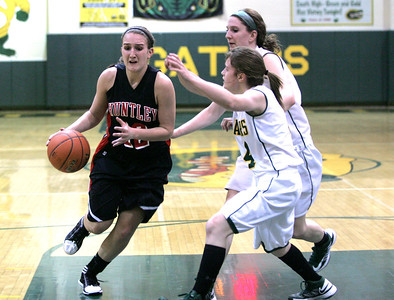 Monica Maschak - mmaschak@shawmedia.com Lady Red Raider Haley Ream faces double the defense as she dribbles down the court in a close game at Crystal Lake South on Wednesday, January 23, 2013. Huntley won 54-52 in double overtime.