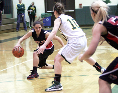 Monica Maschak - mmaschak@shawmedia.com Kayla Barreto faces a Crystal Lake South guard in Wednesday night's close game. The Huntley Red Raiders won 54-52 in double overtime.