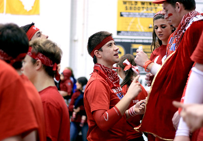 Sarah Nader - snader@shawmedia.com Tim Olson (center), 17, of Sleepy Hollow helps put red makeup on Dundee-Crown fans before Tuesday's boys basketball game against Jacobs in Algonquin on January 15, 2013.