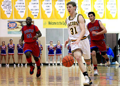 Sarah Nader - snader@shawmedia.com Jacobs' Will Schwerdtmann brings the ball down court during the third quarter of Tuesday's game against Dundee-Crown in Algonquin on January 15, 2013. Jacobs won in overtime, 76-66.
