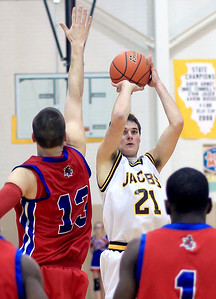 Sarah Nader - snader@shawmedia.com Jacobs' lake Micel shoots over Dundee-Crown's Dylan Kissack  during the fourth quarter of Tuesday's game in Algonquin on January 15, 2013. Jacobs won in overtime, 76-66.
