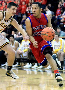 Sarah Nader - snader@shawmedia.com Dundee-Crown's Brandon Rodriguez brings the ball down court during Tuesday's game against Jacobs on January 15, 2013. Jacobs won in overtime, 76-66.
