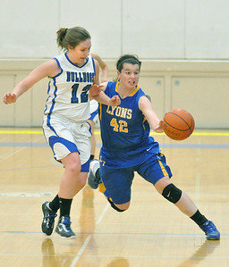 Riverside Brookfield's Hannah Claywell forces Lyons Township's Kayla Morrissey out of bounds for a turnover in the RB's home game against Lyons Township on Friday, Jan. 18, 2013. Bill Ackerman — backerman@shawmedia.com