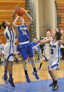 Lyons Township's Carly Oboikovitz shoots a jumper in the paint between Riverside Brookfield's Janae Dabney (left) and Miranda Chavez in the Lions 64-45 win over RB in Riverside on Friday, Jan. 18, 2013. Bill Ackerman — backerman@shawmedia.com