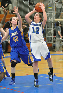 Riverside Brookfield's Hannah Claywell pulls up and shoots from the paint in the Bulldogs home game against Lyons Township on Friday, Jan. 18, 2013. Bill Ackerman — backerman@shawmedia.com