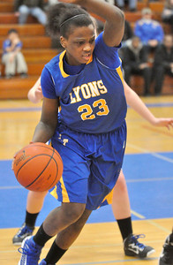 Lyons Township's Ashanti Davis works her way out of a trap in the Lions' 64-45 win over Riverside Brookfield in Riverside on Friday, Jan. 18, 2013. Bill Ackerman — backerman@shawmedia.com