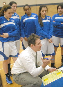 Riverside Brookfield head coach Dallas Till talks to his team during a first quarter timeout in RB's home game against Lyons Township on Friday, Jan. 18, 2013. Bill Ackerman — backerman@shawmedia.com