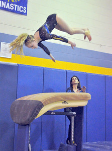 Lyons Township's Alyssa Lancaster performs on vault in the regional gymnastics meet they host on Wednesday, Jan. 30, 2013 in La Grange. Bill Ackerman — backerman@shawmedia.com