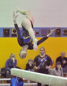 Lyons Township's Katie Carling performs on the beam, scoring a 9.8, in the regional gymnastics meet they host on Wednesday, Jan. 30, 2013 in La Grange. Bill Ackerman — backerman@shawmedia.com