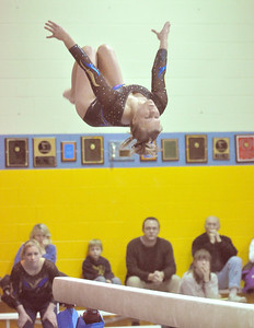 Lyons Township's Maren Craig performs on the beam in the regional gymnastics meet they host on Wednesday, Jan. 30, 2013 in La Grange. Bill Ackerman — backerman@shawmedia.com