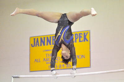Lyons Township's Michelle Cozza performs on the uneven parallel bars in the regional gymnastics meet they host on Wednesday, Jan. 30, 2013 in La Grange. Bill Ackerman — backerman@shawmedia.com