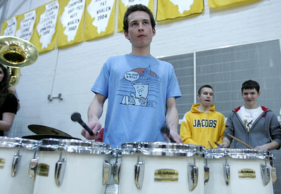 Monica Maschak - mmaschak@shawmedia.com A Jacobs High School percussionist plays the tenor drums during half time of Wednesday night's girls basketball game against Crystal Lake South.