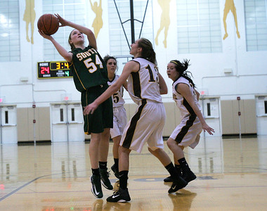 Monica Maschak - mmaschak@shawmedia.com Chanel Fanter (54) shoots for the basket in the fourth quarter of Wednesday night's game at Jacobs High School.  Crystal Lake South won 43-25.