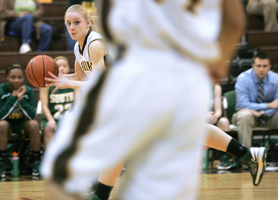Monica Maschak - mmaschak@shawmedia.com Jacobs' Lauren Van Vlierbergen rushes down the court and watches for open teammates in a game against Crystal Lake South on Wednesday, January 9, 2013. Crystal Lake South won 43-25.