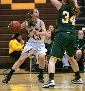 Monica Maschak - mmaschak@shawmedia.com Jacobs' Victoria Tamburrino eyes for a teammate to pass to in a game against Crystal Lake South on Wednesday, January 9, 2013. Crystal Lake South won 43-25.