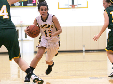 Monica Maschak - mmaschak@shawmedia.com Payton Berg (15) rushes down the court in the first quarter of Wednesday's game against Crystal Lake South. Jacobs lost to Crystal Lake South 43-25.