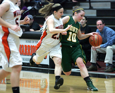 Monica Maschak - mmaschak@shawmedia.com Stephanie Oros (10) battles the pressure of a McHenry guard in the second half of a game on Wednesday, January 30, 2013. The Lady Gators beat the Lady Warriors 51-46.