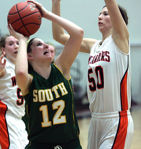 Monica Maschak - mmaschak@shawmedia.com Lady Gator Carly Nolan prepares to shoot the ball over a defender in a game at McHenry West High School on Wednesday, January 30, 2013. Crystal Lake South won 51-46.