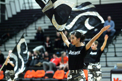 Monica Maschak - mmaschak@shawmedia.com McHenry junior Christina Lim and the rest of the school's Winter Guard perform their 21 Gun routine during the half-time of the girls basketball game on Wednesday, January 30, 2013. The guard will be performing this routine during a competition on Saturday, February 2, 2013.