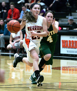 Monica Maschak - mmaschak@shawmedia.com Lady Warrior Carly Mattson races a guard down the court in the first half of a game against Crystal Lake South on Wednesday, January 30, 2013. The Lady Warriors lost to the Lady Gators 51-46.