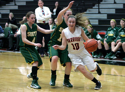 Monica Maschak - mmaschak@shawmedia.com McHenry's Laura D'Angelo cuts infront of a Crystal Lake South Guard in a come-back game on Wednesday, January 30, 2013. The Lady Gators won 51-46.