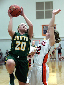 Monica Maschak - mmaschak@shawmedia.com Lady Gator Rachel Rasmussen leaps for the net during a game at McHenry West High School on Wednesday, January 30, 2013. The Lady Gators won 51-46.