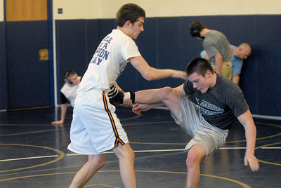 Lemont senior Vince Lietza, left, spars with teammate Jason Walsh during a sparring session at practice on Tuesday, Jan. 15, 2013. Matthew Piechalak— mpiechalak@shawmedia.com.