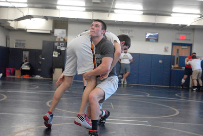 Lemont senior Jason Walsh lifts teammate Vince Lietza during a sparring session at practice on Tuesday, Jan. 15, 2013. Matthew Piechalak— mpiechalak@shawmedia.com.