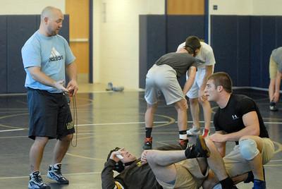 Lemont Varsity Wrestling Coach John St. Clair, left, instructs senior Chris Giatras, right, during practice on Tuesday, Jan. 15, 2013. Matthew Piechalak— mpiechalak@shawmedia.com.