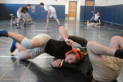 Lemont senior Chris Giatras, left, spars with one of his assistant coaches during a practice on Tuesday, Jan. 15, 2013. Matthew Piechalak— mpiechalak@shawmedia.com.