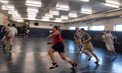 The Lemont Varsity Wrestling team runs sprints at practice on Tuesday, Jan. 15, 2013. Matthew Piechalak— mpiechalak@shawmedia.com.