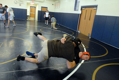 Lemont senior Chris Giatras, bottom, spars with one of his assistant coaches during a practice on Tuesday, Jan. 15, 2013. Matthew Piechalak— mpiechalak@shawmedia.com.