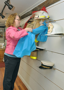On Wednesday, Jan. 23, 2013, Sarah Richardt, senior program coordinator, prepares an exhibit marking the Lombard Fire Department's centennial, in the Lombard Historical Society's carriage house. Bill Ackerman — backerman@shawmedia.com
