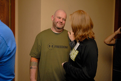 Mike Johnson smiles while talking to his wife, Jennifer, a lung transplant nurse at Loyola Hospital, as the two wait in line for a practice climb during Lung Health Champions Night at Hilton Suites, 198 E. Delaware Pl. in Chicago on Thursday, Jan. 10, 2013. The Johnson's, of Brookfield, will participate in the Respiratory Health Association's Hustle Up the Hancock on February 24. Matthew Piechalak— mpiechalak@shawmedia.com.