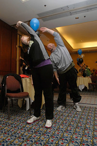 Jennifer Johnson, a lung transplant nurse at Loyola Hospital, and her husband, Mike, who was diagnosed with a lung disease in 2009, participate in group stretches prior to a practice climb during Lung Health Champions Night at Hilton Suites, 198 E. Delaware Pl. in Chicago on Thursday, Jan. 10, 2013. The Johnson's, of Brookfield, will participate in the Respiratory Health Association's Hustle Up the Hancock on February 24. Matthew Piechalak— mpiechalak@shawmedia.com.