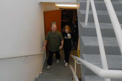 Jennifer Johnson, a lung transplant nurse at Loyola Hospital, and her husband, Mike, who was diagnosed with a lung disease in 2009, begin their practice climb during Lung Health Champions Night at Hilton Suites, 198 E. Delaware Pl. in Chicago on Thursday, Jan. 10, 2013. The Johnson's, of Brookfield, will participate in the Respiratory Health Association's Hustle Up the Hancock on February 24. Matthew Piechalak— mpiechalak@shawmedia.com.