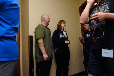 Jennifer Johnson, a lung transplant nurse at Loyola Hospital, and her husband, Mike, who was diagnosed with a lung disease in 2009, wait in line for a practice climb during Lung Health Champions Night at Hilton Suites, 198 E. Delaware Pl. in Chicago on Thursday, Jan. 10, 2013. The Johnson's, of Brookfield, will participate in the Respiratory Health Association's Hustle Up the Hancock on February 24. Matthew Piechalak— mpiechalak@shawmedia.com.