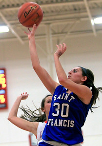 Sarah Nader - snader@shawmedia.com St. Francis's Aly Germanos makes a shot during the second quarter of Monday's game against Marian Central in Woodstock on January 14, 2013. Marian Central lost, 43-54.