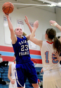 Sarah Nader - snader@shawmedia.com St. Francis's Kate Slattery makes a shot during the first quarter of Monday's game against Marian Central in Woodstock on January 14, 2013. Marian Central lost, 43-54.
