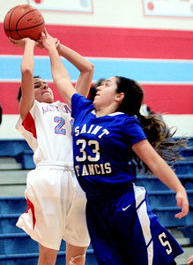 Sarah Nader - snader@shawmedia.com St. Francis's Leah Riccolo (right) blocks a shot by a Marian Central player during the fourth quarter of Monday's game in Woodstock on January 14, 2013.