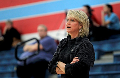 Sarah Nader - snader@shawmedia.com Marian Central's head girls basketball coach Jackie Budmayr watches Monday's game against St. Francis in Woodstock on January 14, 2013. Marian Central lost, 45-54.