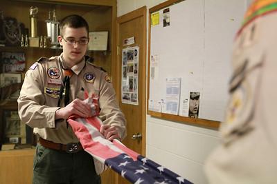 Matt Walden folds a flag that was left at the Berwyn VFW to be retired on Thursday, Jan. 10. Sarah Minor — sminor@shawmedia.com